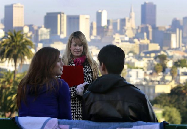 "Ryan Lynch (center) directs a rehearsal of a ""SanFranLand"" scene with actors Ashley Chaney (left) and Art Hsu. Below, production assistant Jessica Wan holds a slate. Photo: Paul Chinn, The Chronicle"