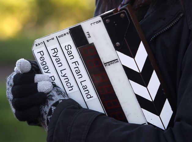 """Production assistant Jessica Wan clutches the slate before a scene is filmed for """"San Fran Land"""" at Dolores Park in San Francisco, Calif. on Saturday, Dec. 8, 2012. Photo: Paul Chinn, The Chronicle"""