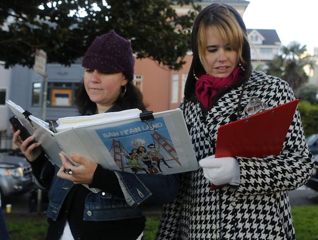 """Script supervisor Lisa Fotheringham (left) and director Ryan Lynch review the script before filimng a scene for """"San Fran Land"""" at Dolores Park in San Francisco, Calif. on Saturday, Dec. 8, 2012. Photo: Paul Chinn, The Chronicle"""